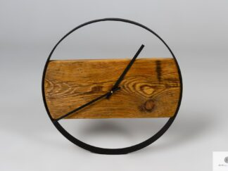 Wall clock of wood with black metal ring