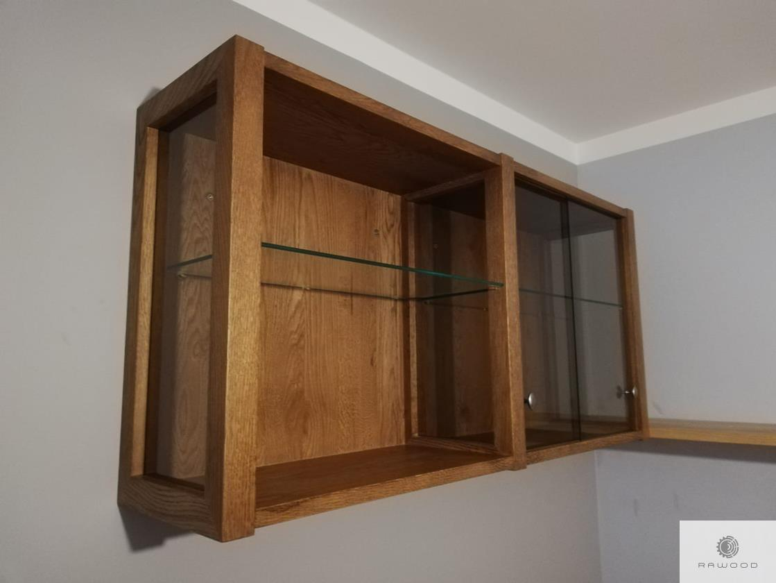 Wooden shelves of oak wood and glass to office